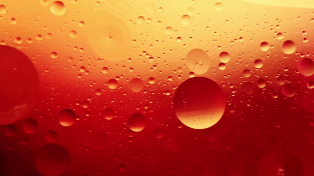 orange bubble abstract, oil and water - orange colour stock videos & royalty-free footage