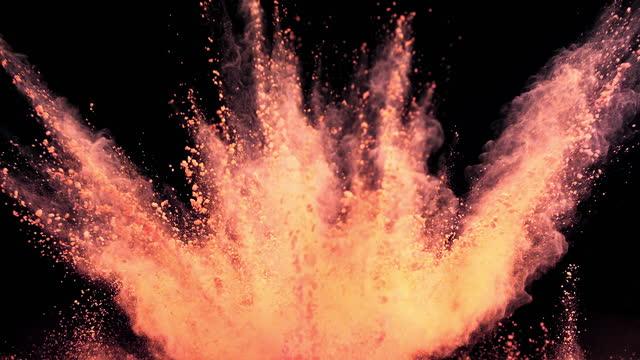 orange color powder explosion super slow motion - orange colour stock videos & royalty-free footage