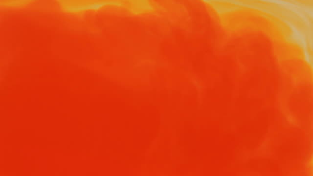 orange dye dissolving - dissolving stock videos & royalty-free footage