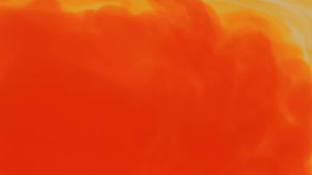 orange dye auflösen - orange farbe stock-videos und b-roll-filmmaterial