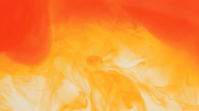 orange dye dissolving - orange colour stock videos & royalty-free footage