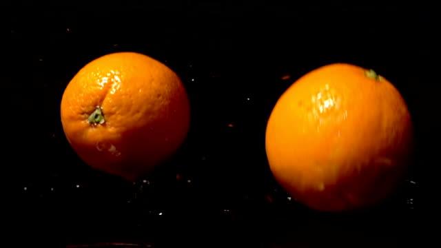 Orange Falling And Splashing