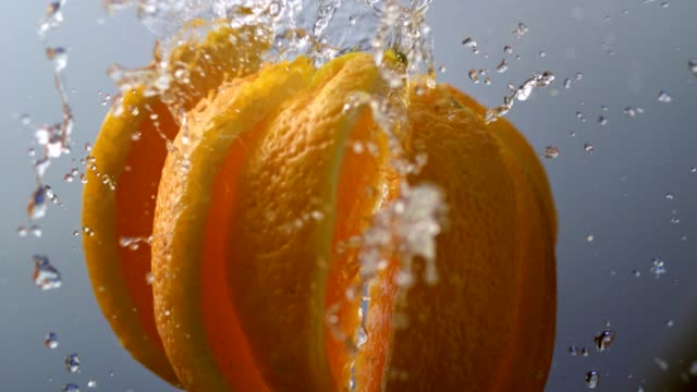 orange falling apart into slices. super slow motion - orange stock videos & royalty-free footage