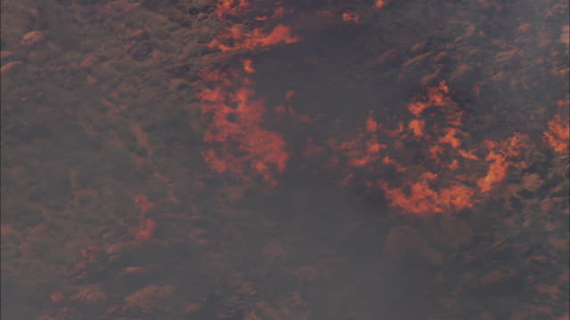 aerial zo orange flames and black smoke rising from large bushfire spreading through vegetation, darwin, northern territory, australia - drought stock videos & royalty-free footage