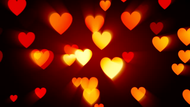 orange heart background (loopable) - orange stock videos & royalty-free footage