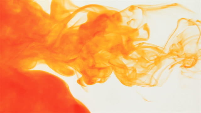Orange ink dropped in water