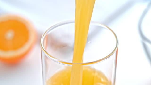 SLO MO Orange juice being poured into a glass