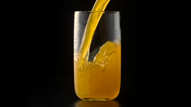 orange juice drink pouring into glass - carbonated drink stock videos & royalty-free footage