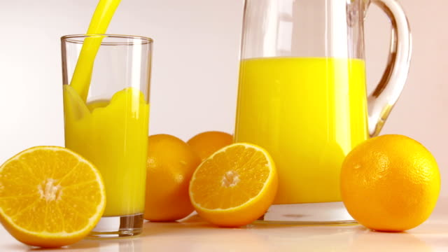 orange orangensaft - orangensaft stock-videos und b-roll-filmmaterial