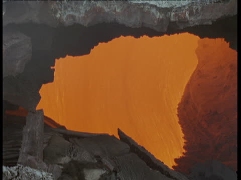 orange lava flows inside encrusted lava tube, hawaii - tubing stock videos and b-roll footage