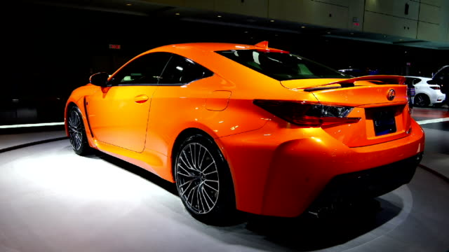 orange lexus rc f in the canadian international autoshow which is canada's largest automotive show held annually at the metro toronto convention... - strategia di vendita video stock e b–roll