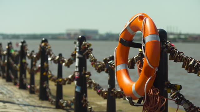 orange lifebuoy ring beside river - love emotion stock videos & royalty-free footage