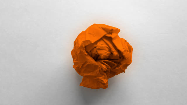 orange paper ball wrinkled - crumpled paper stock videos and b-roll footage