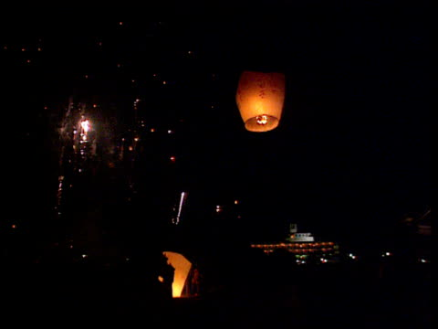 orange paper balloons launched into night sky at moon festival fireworks exploding all around taiwan - taiwan stock videos & royalty-free footage