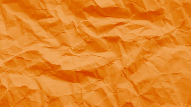 orange paper texture wrinkled - orange colour stock videos & royalty-free footage
