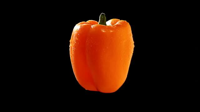 Orange Pepper Spinning on Black