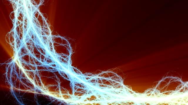orange rays of light flicker behind a stream of electric strings. - spiralmuster stock-videos und b-roll-filmmaterial