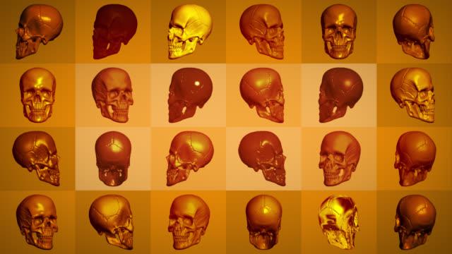 orange skulls rotating on coloured squares - tomb stock videos & royalty-free footage