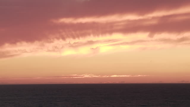 ws orange sky after sunset in southern france / cap de l'homy, aquitaine, france - aquitaine stock videos and b-roll footage