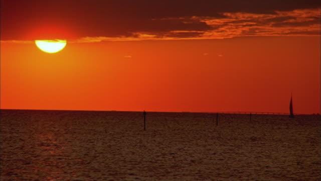 ws, orange sky at sunset above tampa bay, florida, usa - tampa stock videos & royalty-free footage