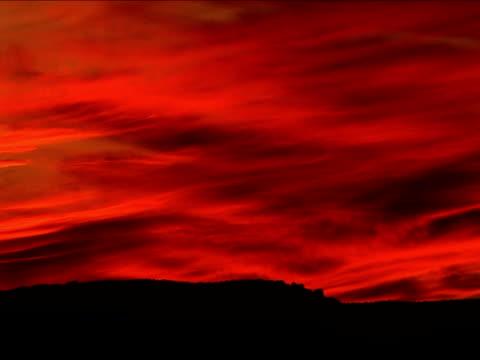 ws, orange sky at sunset, utah, usa - stationary process plate stock videos & royalty-free footage