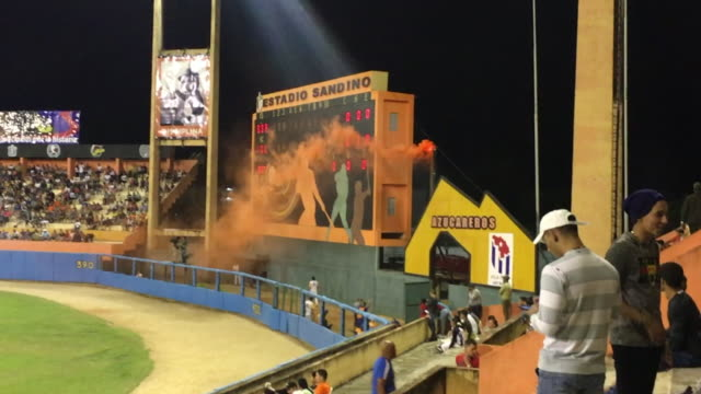 orange smoke gets out an improvised chimney. orange is the color of the home club team villa clara. the general ambiance in the 'augusto cesar... - semifinal round stock videos & royalty-free footage