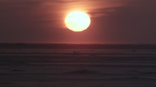 orange sun sets over arctic tundra, canada - manitoba stock videos & royalty-free footage