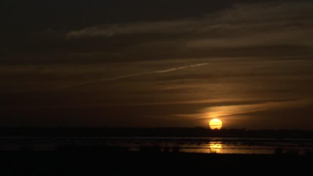 orange sun sets over lake tsimanampetsotsa, madagascar - orange colour stock videos & royalty-free footage