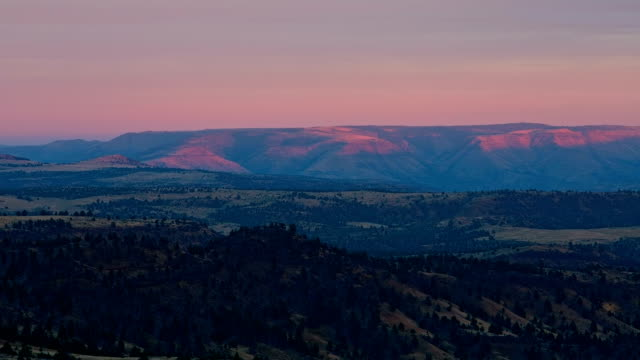 Orange Sunrise Over the valley and town of Spray, Oregon