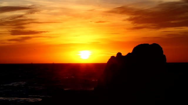 orange sunset beach rock boats and seagulls - sea of cortez stock videos & royalty-free footage