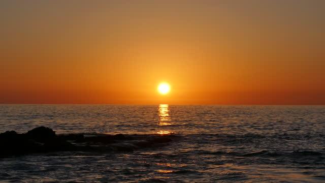 orange sunset over the pacific ocean laguna beach - laguna beach california stock videos & royalty-free footage