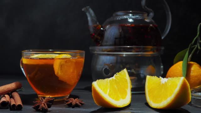 orange tea over black - teapot stock videos & royalty-free footage