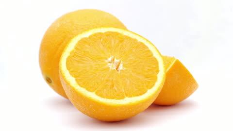 vidéos et rushes de orange - aliment en portion