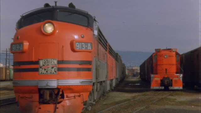 orange western pacific freight train in depot moves towards camera, usa; 1960s available in hd. - shunting yard stock videos and b-roll footage