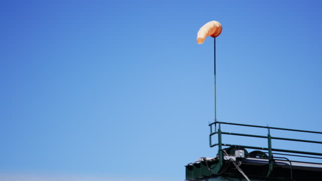 orange windsock blows in wind - puget sound stock videos & royalty-free footage