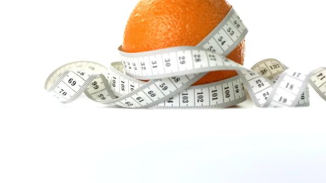 HD: Orange Wrapped In Measuring Tape