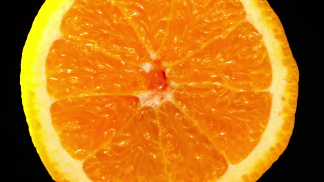 orange zoom in slowly with black background - fruit juice stock videos & royalty-free footage