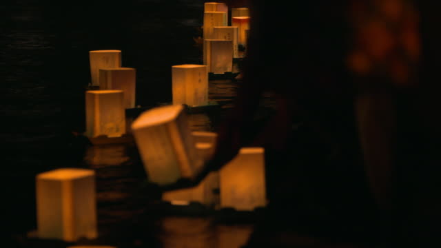 orange-colored floating lanterns - lantern stock videos & royalty-free footage