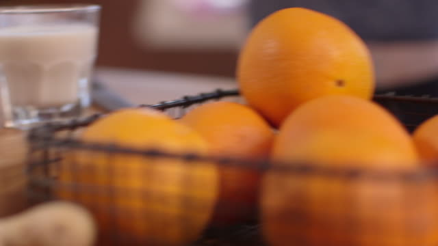 oranges in a basket and raw ginger (and almond milk) - soy milk almond milk stock videos & royalty-free footage