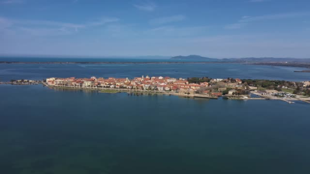 orbetello lagoon in tuscany from a drone - tuscany stock videos & royalty-free footage