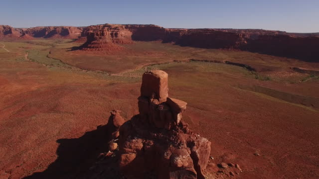 Orbit around rock spire epic ,4K Drone Reveal, Aerial Monument Valley, Valley of the Gods Epic desert view