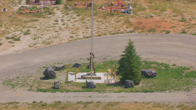 ms aerial zo ts orbit statue of sacajawea and gravesite with indian cemetery / fort washakie, wyoming, united states - place concerning death stock videos and b-roll footage