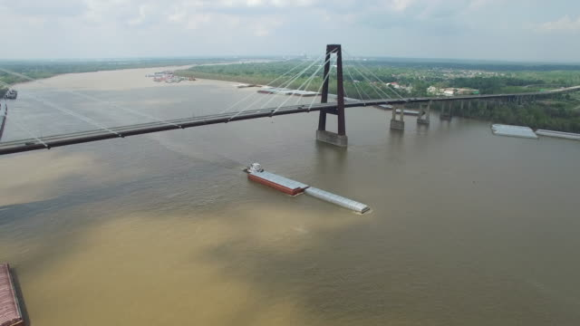 Orbit to bardge on river - Drone Aerial 4K Mississippi river bridge and barge 1of14, everglades, gulf delta, new orleans, st louis, with cruise boats sailing and wildlife 4K Transportation Drone Aerial Video