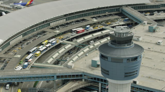 stockvideo's en b-roll-footage met orbital of the air traffic control tower at the laguardia airport - transportatiegebouw