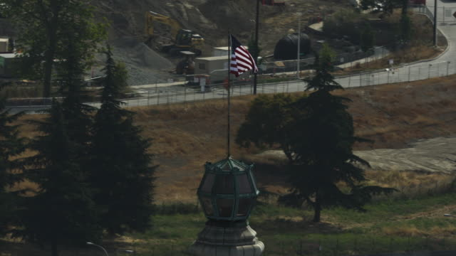 Orbital shot of a U.S. flag on the top of the Smith Tower