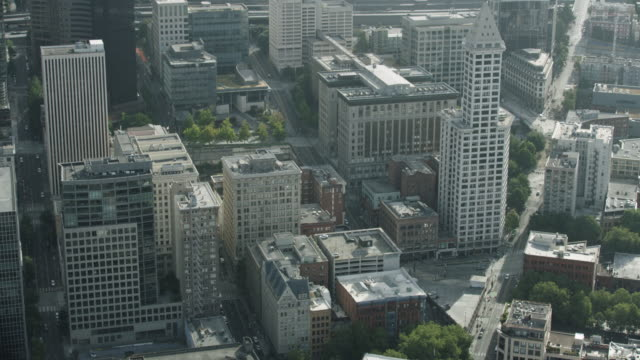 orbital shot of buildings in downtown seattle - smith tower stock videos & royalty-free footage