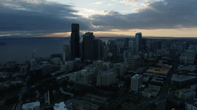 orbital shot of downtown seattle at sunrise - smith tower stock videos & royalty-free footage
