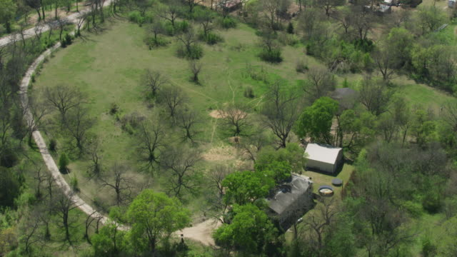 orbital shot of farm houses at eagle mountain area - backwater stock videos & royalty-free footage
