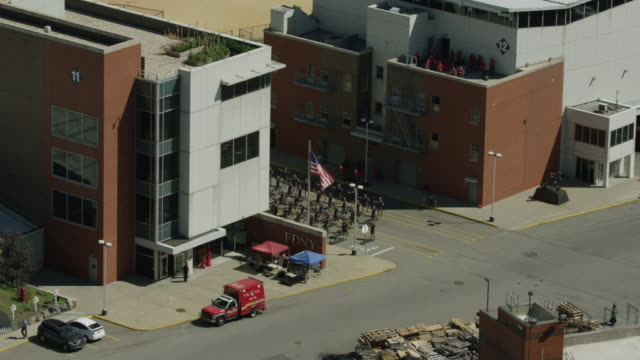 orbital shot of firefighter trainees doing physical exercise at the fire department of the city of new york training center - fire department of the city of new york stock videos and b-roll footage