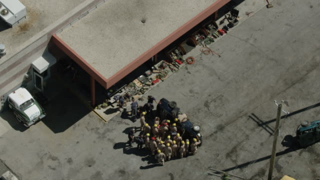 orbital shot of firefighter trainees watching a demonstration of opening crashed cars at the fire department of the city of new york training center - fire department of the city of new york stock videos and b-roll footage